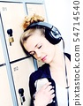 attractive blond female student with headphones 54714540