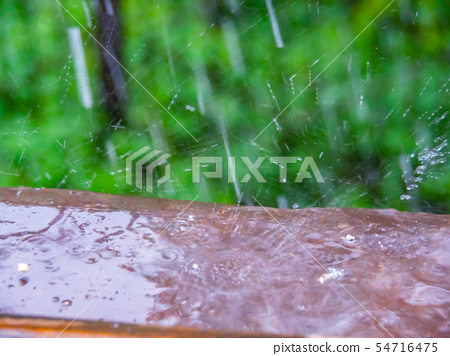 Rain photographed from opened window, close up 54716475