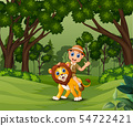 Zookeeper man with a lion walking in the jungle 54722421