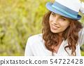 Portrait of a woman on green field in summer 54722428