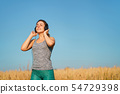 Sporty woman enjoy music in earphones at workout 54729398