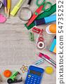 Assorted school supplies on wooden background, top view. 54735252