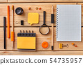 Set of office stationery with notebook on table. 54735957