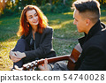 Beautiful couple spend time in a summer park 54740028