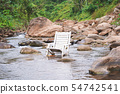 White wooden beach chair in the river. 54742541