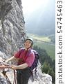 woman is climbing 54745463