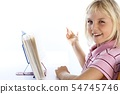smiling girl is reading 54745746