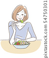 A woman eating a salad 54750301