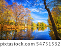 Sunny autumn in the park over lake 54751532