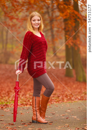 Fashion woman with umbrella relaxing in fall park. 54753177