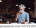 Senior man having a beer in the bar 54754160