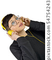 Young Woman wearing headphones listening to music 54754243