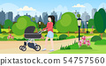 mother with her baby in stroller walking outdoor woman pushing pram with newborn child happy family 54757560