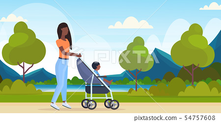 mother with toddler son in stroller walking outdoor african american woman pushing pram with child 54757608