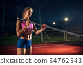 Female pole vaulter training at the stadium in the evening 54762543