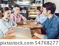 Friends enjoying in the coffee shop 54768277