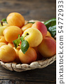 Sweet apricots on the wooden table 54772933