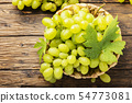 Sweet yellow grape with leaves 54773081