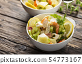 salad with seafood, potato and celery 54773167