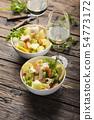 salad with seafood, potato and celery 54773172