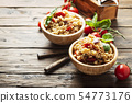 Vegetaian rice with onion, tomato and eggplant 54773176