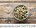 Salt capers on the wooden table 54773196