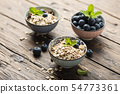 Mix of homemade cereal with blueberry and mint 54773361