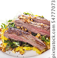 flank steak with mashed plantain , collard greens 54777073