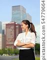 Asian businesswoman happy in urban Tokyo city 54779664