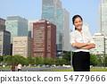Businesswoman in Tokyo city skyline, Japan 54779666