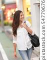 Shopping woman walking in Harajuku street, Tokyo 54779676