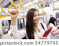 Subway commuter woman on Tokyo public transport 54779745