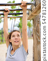 Woman training on fitness ladder monkey bars 54781260