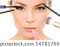Makeup brushes concept - woman beauty face 54781769