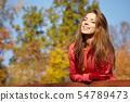 Fashion woman walking in autumn park 54789473