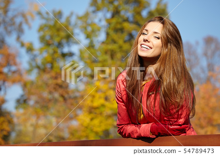 Fashion woman walking in autumn park 54789473