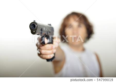 a woman with gun 54799019