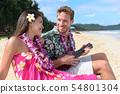 Couple fun on beach playing ukulele on Hawaii 54801304