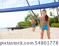 Beach volleyball serve - man serving in game 54801778