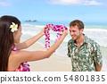 Hawaii woman giving lei garland welcoming tourist 54801835
