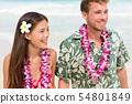 Happy Hawaii beach couple in Aloha Hawaiian shirt 54801849