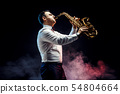 Handsome adult man playing saxophone 54804664
