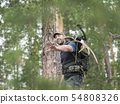 View of a hunter in the woods carries moose horns on his back 54808326