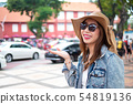 Young asian woman enjoys her holiday in Malacca 54819136