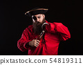 Portrait of a medieval bearded pirate opening a bottle with his hand hook for halloween 54819311