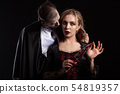 Portrait of a beautiful couple in medieval costumes with vampire style make-up for halloween 54819357