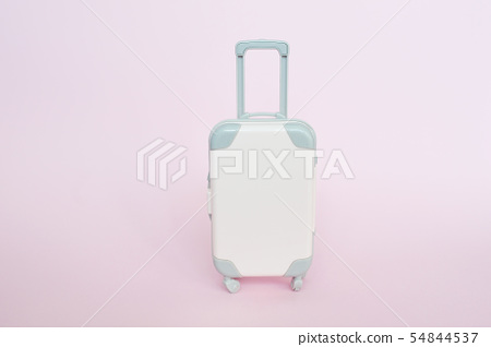 Stylish suitcase on pink background, top view with place for text. Concept for travel 54844537