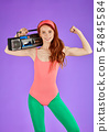motivated fit female model girl standing with portable audio player, showing biceps 54845584