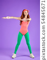 view of active red-haired fitness girl dressed in 80s style 54845671