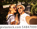 cute couple makes selfie on the street 54847099